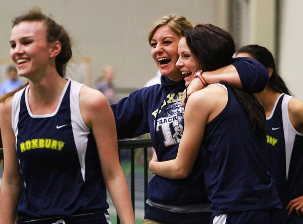 Roxbury celebrates its victory in the 1,600 sprint medley at the Morris County Relays with one of its coaches.