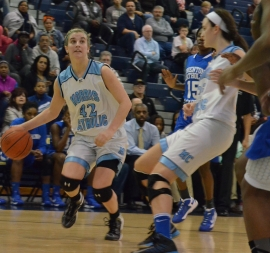 Morris Catholic junior guard Alexa Giuliano dribbles the ball.