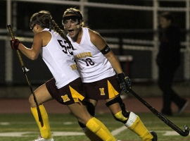 Madison's Elizabeth Turnbull shouts with joy at teammate Katie Battaglia afte Battaglia scored the first goal of the game.