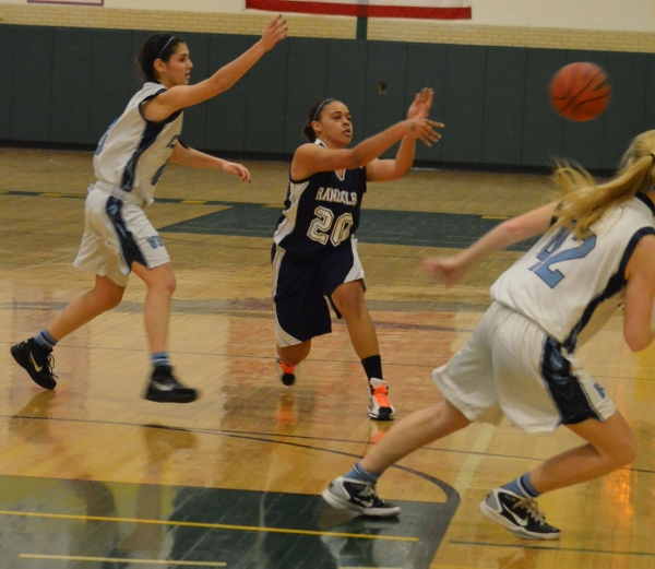 Ashley Pledger of Randolph, center, makes a pass in a MCT quarterfinal game.