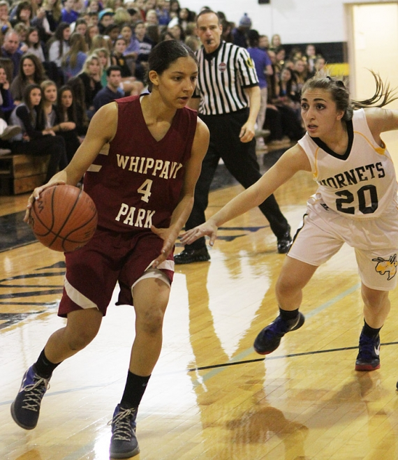 Alana Dudley, left, is guarded by Hanover Park&#039;s Liana Ilutzi during a game in December of 2012. In the slideshow photo, Dudley poses with Whippany Park coach Tom Wilson, New Jersey Panthers AAU coach John Griff and her parents, Moss and Gina, after signing her letter of intent.