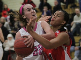 Chatham's Grace Conroy goes strong to the basket with Imani West of Columbia guarding.