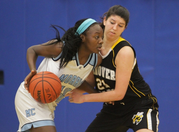 Sade Idera of Morris Catholic is defended by Lauren Daugherty of Hanover Park.