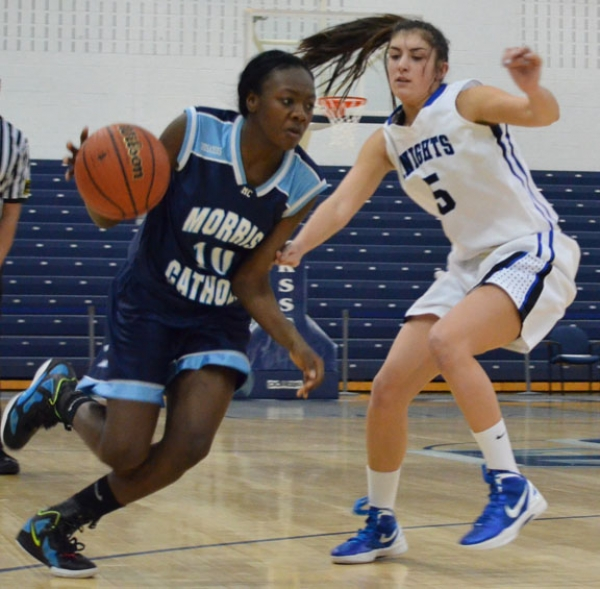 Sade Idera of Morris Catholic drives past Sam Graber of Gill-St. Bernard's.