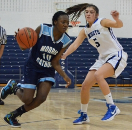Sade Idera of Morris Catholic drives past Sam Graber of Gill-St. Bernard&#039;s.
