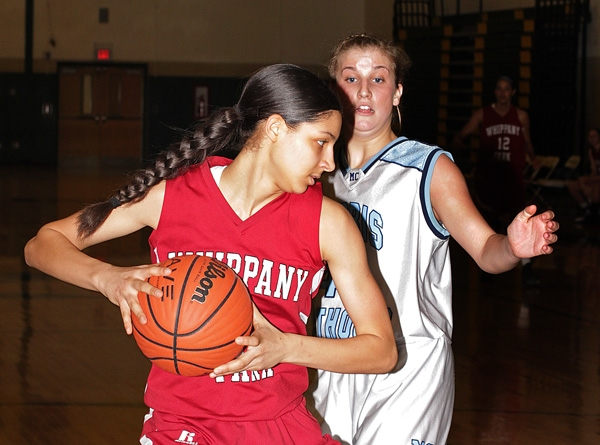 Alana Dudley of Whippany Park looks to pass the ball while being guarded by Alexa Giuliano of Morris Catholic.