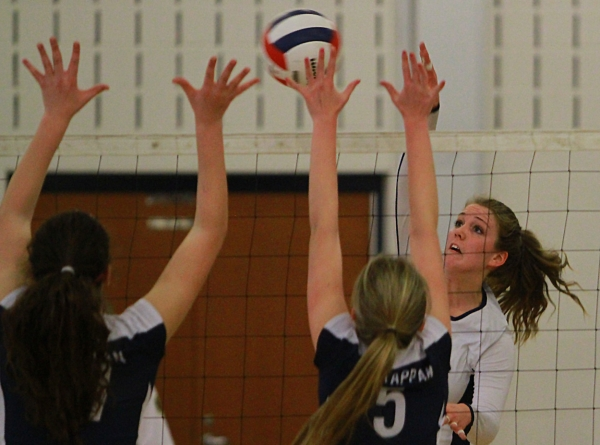 Annie Halbert attempts a kill over two Old Tappan defenders.