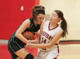Christine Jones of Whippany Park fights Morgan Browning of Kinnelon for the ball.