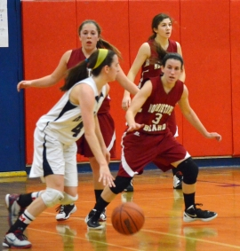 Mendham's Liz Malman, left, dribbles while being guarded by Morristown-Beard's Jamie Cossolini in non-conference action.