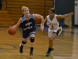 Morris Catholic's Alexa Giuliano dribbles while being guarded by Roselle Catholic's Niavanni Grant.