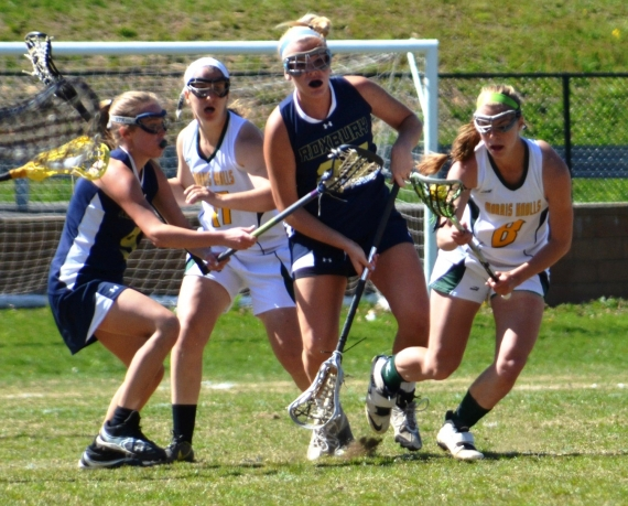 Morris Knolls' Jacie Cooper, right, tries to elude Roxbury defenders Amanda Beal and Katie Cikovsky.