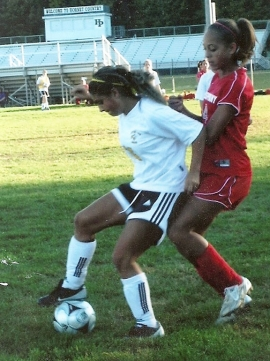 Gianna Tino, left, controls the ball in a game against Parsippany.