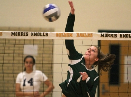 Kelsey O'Connor makes a kill for Morris Knolls.