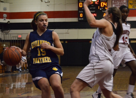 Pequannock junior guard Kendall Machak dribbles the ball.