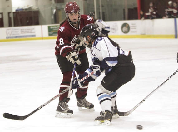 Kristen DePoalo of Morristown-Beard gets the puck past Princeton defender Kate Sohn and scores.