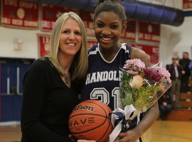 Aliyah Huland El and Randolph coach Kristin Torres pose for a picture after Huland El scored her 1,000th point.