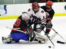 A Morristown-Beard player, in white jersey, tries to get the puck past the Quarry Cats&#039; goalie earlier this season.