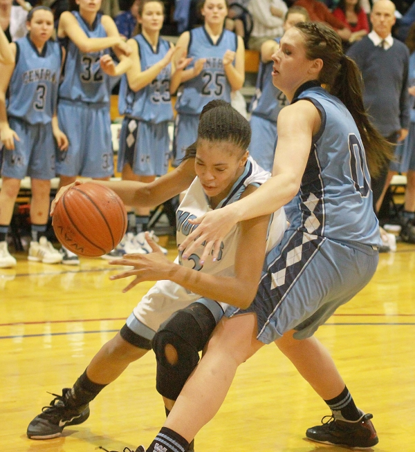 Shayna Ericksen, right, guards Morris Catholic's Danni Brown in a Morris County Tournament semifinal last winter. Ericksen, of West Morris, has accepted a scholarship from Manhattan College.