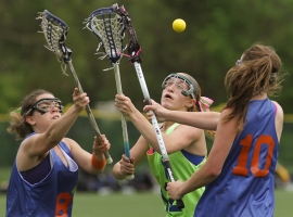 Montville's Shelby Labe, center, battles against Pequannock's Steph Reda and Caitlyn Horgan.