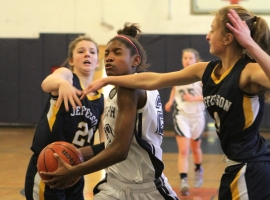 Randolph's Aliyah Huland El goes hard to the basket agains Jefferson.
