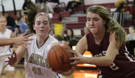 Roxbury's Sydney Clevenger and Morristown's Abby Schubiger vie for control of the ball.