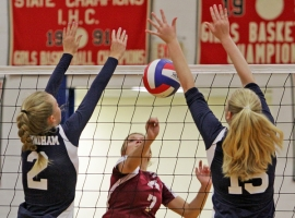 Mendham blockers Natalie Knudsen and Mikki Sharp attempt to block a shot by Morristown's Bradley Taylor.