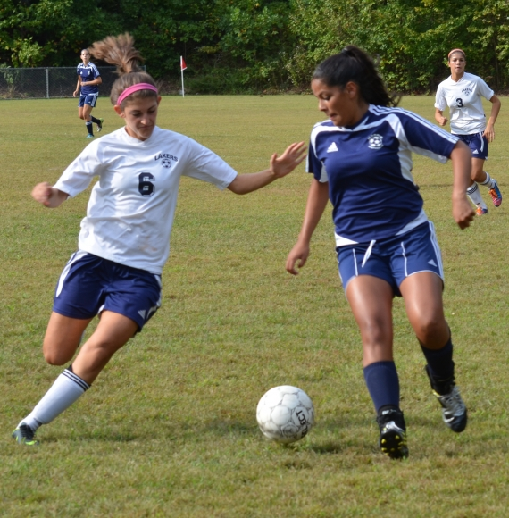 The Lakers' Aleeza Grodofsky, left, moves in on the ball. The Morris Catholic player is Sam Garzon.